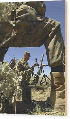 A U.s. Marine Mortarman Trains On An Wood Print by Stocktrek Images