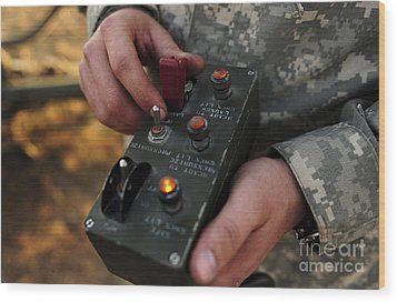 A U.s. Soldier Hits The Button Wood Print by Stocktrek Images