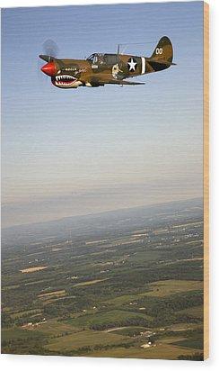 A Vintage World War II P-40n Fighter Wood Print by Pete Ryan