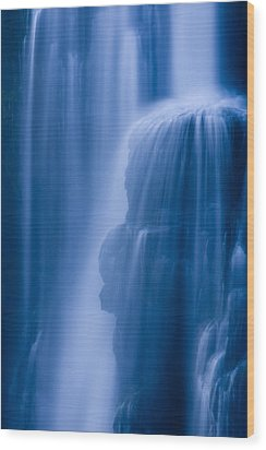 A Waterfall Splashes Off Of A Large Wood Print by Ralph Lee Hopkins