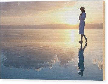 A Woman Enjoys The Warm Sun On The Edge Wood Print by Taylor S. Kennedy