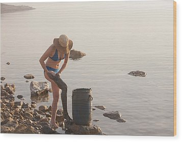 A Woman Smears Therapeutic Dead Sea Mud Wood Print by Taylor S. Kennedy