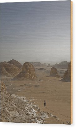 A Woman Walks Down A Sand Dune Wood Print by Taylor S. Kennedy