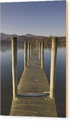 A Wooden Dock Going Into The Lake Wood Print by John Short