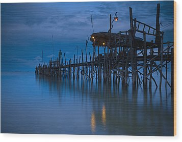 A Wooden Pier With Lights On It At Wood Print by David DuChemin