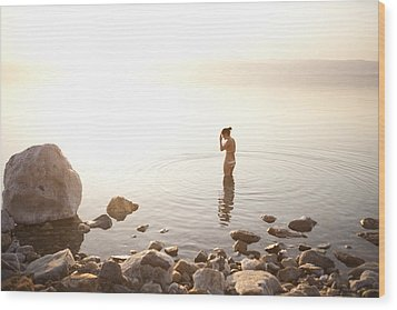 A Young Woman Wades Into The Dead Sea Wood Print by Taylor S. Kennedy