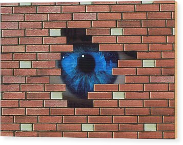 Abstract Of Eye Looking Through Hole In Brick Wall Wood Print by Mehau Kulyk