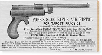 Advertisement: Air Pistol Wood Print by Granger