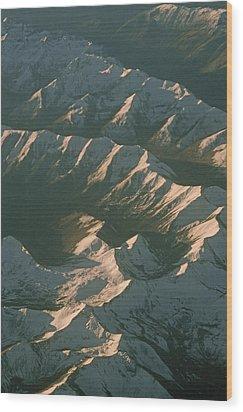 Aerial View Of Snowcapped Mountain Wood Print by Gordon Wiltsie