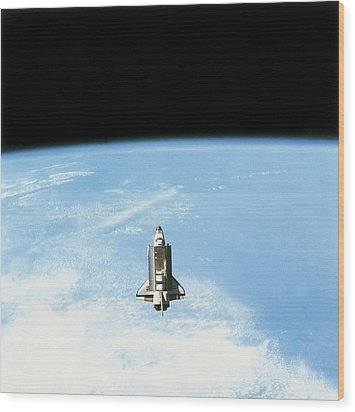 Aerial View Of The Space Shuttle In Orbit Above Earth Wood Print by Stockbyte