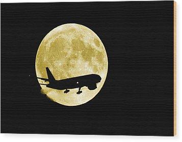Aeroplane Silhouetted Against A Full Moon Wood Print by David Nunuk
