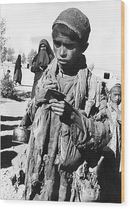 Afghan Youngster In A Unicef Feeding Wood Print by Everett