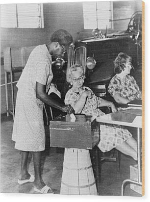 African-american Woman Placing Ballot Wood Print by Everett