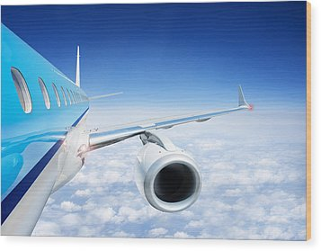 Airliner In Flight Above The Clouds Wood Print by Corepics