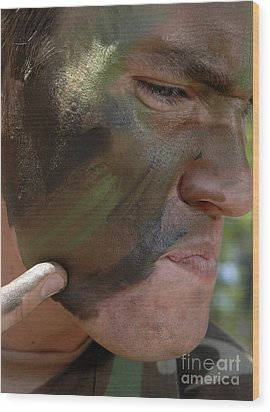 Airman Applies War Paint To His Face Wood Print by Stocktrek Images