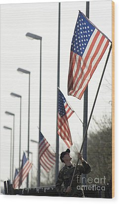 Airman Posts A New Flag On The Main Wood Print by Stocktrek Images