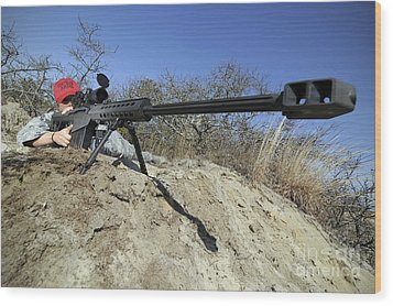 Airman Sights A .50 Caliber Sniper Wood Print by Stocktrek Images