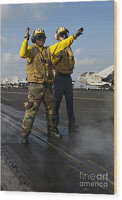 Airmen Direct An Fa-18c Hornet Wood Print by Stocktrek Images