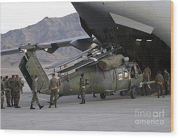 Airmen Load An Hh-60 Pave Hawk Wood Print by Stocktrek Images