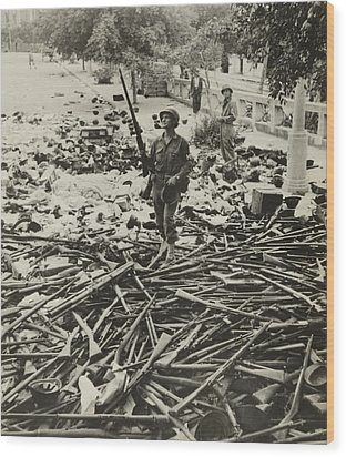 American M.p. Standing On A Large Pile Wood Print by Everett