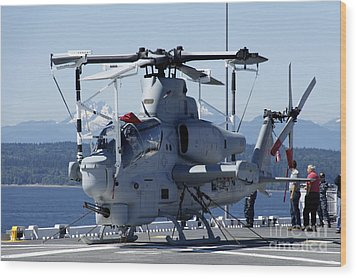 An Ah-1w Cobra Is Chained To The Flight Wood Print by Stocktrek Images