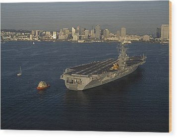 An Aircraft Carrier With The Skyline Wood Print by Phil Schermeister