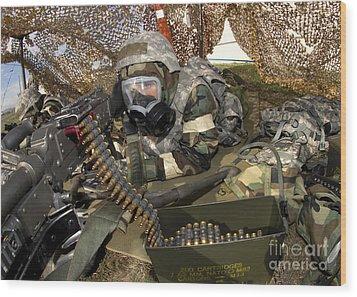 An Airman Defends Her Position Firing Wood Print by Stocktrek Images