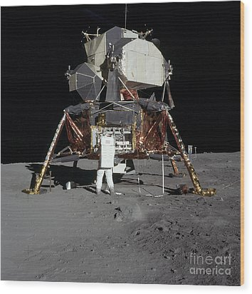 An Apollo 11 Astronaut In Front Wood Print by Stocktrek Images