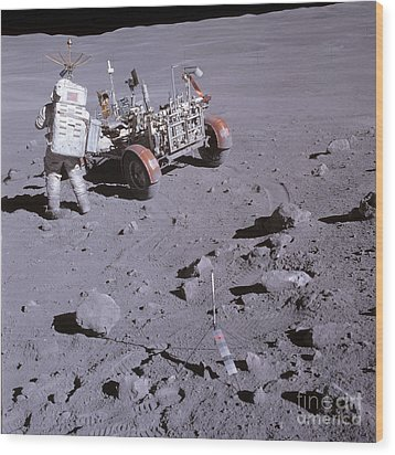 An Astronaut And A Lunar Roving Vehicle Wood Print by Stocktrek Images