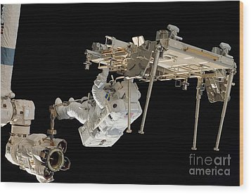 An Astronaut With His Feet Secured Wood Print by Stocktrek Images