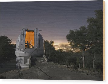 An Astronomer Works Inside A Dome Wood Print by Jim Richardson
