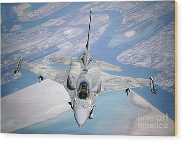 An Emirati F-16 Conducts A Training Wood Print by Stocktrek Images