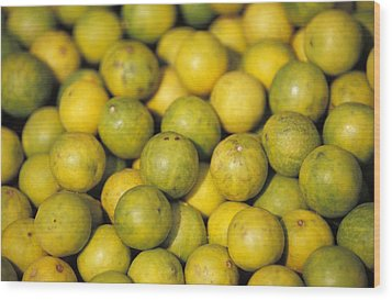 An Enticing Display Of Lemons Wood Print by Jason Edwards