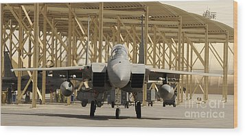 An F-15 Eagle Taxis Prior To A Training Wood Print by Stocktrek Images