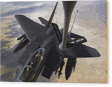 An F-15e Strike Eagle Aircraft Receives Wood Print by Stocktrek Images