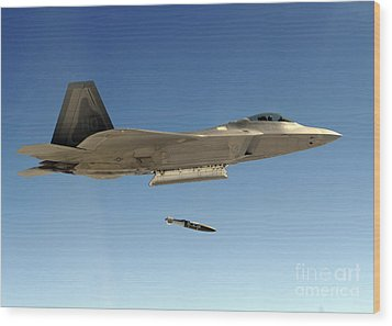 An F-22a Raptor Drops A Gbu-32 Bomb Wood Print by Stocktrek Images