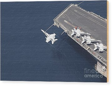 An Fa-18 Hornet Flys Over Aircraft Wood Print by Stocktrek Images