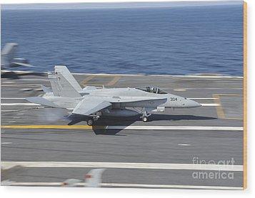 An Fa-18c Hornet Lands Aboard Uss Wood Print by Stocktrek Images
