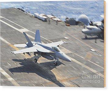 An Fa-18e Super Hornet Lands Aboard Wood Print by Stocktrek Images