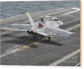 An Fa-18f Super Hornet Traps An Wood Print by Stocktrek Images