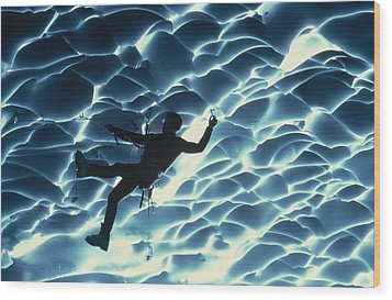 An Ice Climber Crosses The Ceiling Wood Print by Carsten Peter