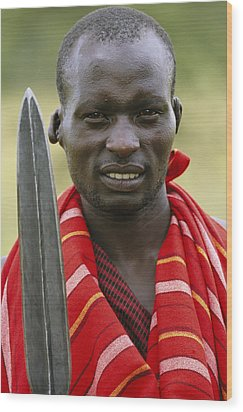 An Informal Portrait Of A Masai Warrior Wood Print by Michael Melford