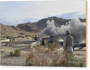 An M198 Howitzer Fires A 155-millimeter Wood Print by Stocktrek Images