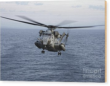 An Mh-53e Sea Dragon In Flight Wood Print by Stocktrek Images