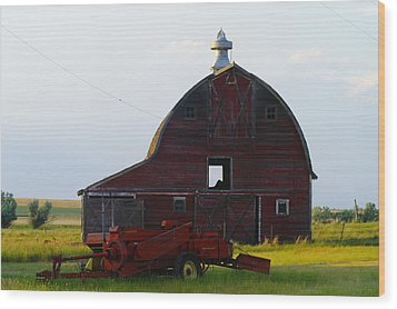 an old barn and bailor in Eastern Montana Wood Print by Jeff Swan