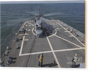 An Sh-60b Sea Hawk Lands On The Flight Wood Print by Stocktrek Images