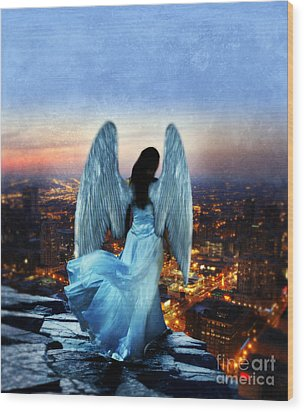 Angel On Rocky Ledge Above City At Night Wood Print by Jill Battaglia