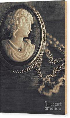 Antique Cameo Medallion On Wood Wood Print by Sandra Cunningham