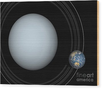 Artists Concept Of Uranus And Earth Wood Print by Walter Myers