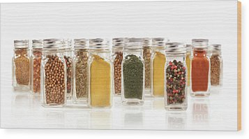 Assorted Spice Bottles Isolated On White Wood Print by Sandra Cunningham